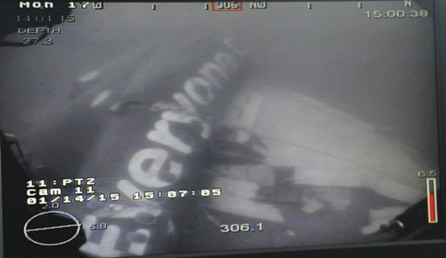 Handout image shows a part of the fuselage of the AirAsia Flight QZ8501 in the Java Sea