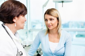 woman-visiting-with-doctor
